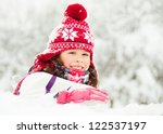 happy child in red hat on snow | Shutterstock . vector #122537197