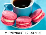 Espresso and macaroons, studio shot - stock photo