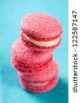 Stack of pink macaroons, vertical shot, close-up - stock photo