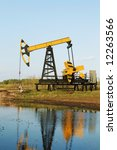 Oil-well on the landscape. Industrial background - stock photo
