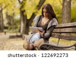 Young Woman With Tablet On The...