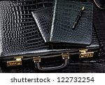 Crocodile leather case with wallet and pencil - stock photo