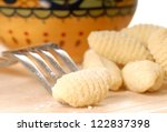 Delicious hand made Gnocchi using a fork - stock photo