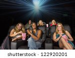 A group of people watching a movie showing emotion - stock photo