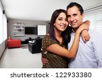 Young happy couple at their new modern house - stock photo