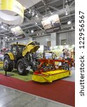 Small photo of MOSCOW, OCT 11: Tractor with mounted mower brand Challenger MT585D American company AGCO AGROSALON at the international exhibition in Moscow in October 11.2012