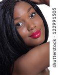 beautiful young African American woman with long black hair and bright makeup - stock photo