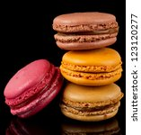 Four Colorful Macarons Isolate...
