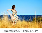 Girl near the seaside  enjoying summer - stock photo