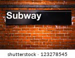 New York City subway sign entrance on brick wall - stock photo