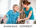 senior woman with her caregiver ... | Shutterstock . vector #123430627