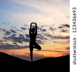 silhouette of young woman doing ... | Shutterstock . vector #123436693