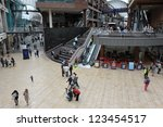 BRISTOL - SEPT 21: Shoppers walk through the newly opened Cabot Circus shopping centre on Sept 21, 2012 in Bristol, UK. Cabot Circus boasts 1,000,000 sq ft of retail outlets and leisure facilities. - stock photo