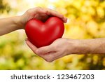 red heart in woman and man... | Shutterstock . vector #123467203
