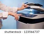 woman's hand with working copier | Shutterstock . vector #123566737