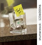 tip jar with thank you note - stock photo