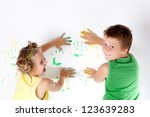Portrait of a beautiful childs enjoying his painting - stock photo