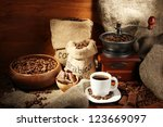 Coffee Grinder And Cup Of...