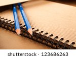 Notepad, blue pencils and paper folder - stock photo