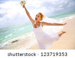 cheerful bride showing... | Shutterstock . vector #123719353