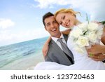 groom holding bride in his arms ... | Shutterstock . vector #123720463