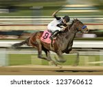 "ARCADIA, CA - JAN 5: Jockey Joseph Talamo pilots ""Bench Press"" to a third place finish in a maiden race at Santa Anita Park on Jan 5, 2013 in Arcadia, CA. - stock photo"