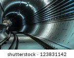 Underground facility with a big tunnel leading deep down - stock photo