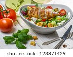 Closeup of healthy salad with chicken and ingredients - stock photo