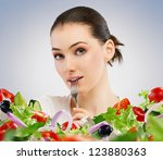 a beautiful girl eating healthy ... | Shutterstock . vector #123880363
