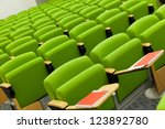 Green seats in big empty hall - stock photo