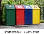 Different Colored Bins For Collection Of Recycle Materials - stock photo