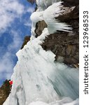 Ice Climbing A Wall Of Ice In...