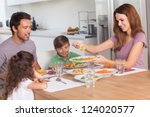 mother serving vegetables to... | Shutterstock . vector #124020577