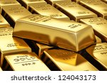 Macro View Of Stacks Of Gold...