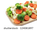 Different frozen vegetables on a cutting board - stock photo