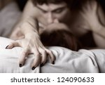 Stock photo young couple making love in bed focus on hand 124090633