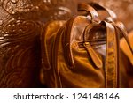 A brown ladies handbag against a brown wooden board - stock photo