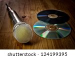 Wireless microphone for karaoke, wooden background with copyspace - stock photo