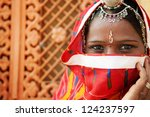 Traditional Indian woman in sari costume covered her face with veil, India - stock photo