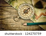 old map and compass on a wooden table - stock photo