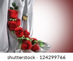 isolate holiday background with roses, jewellery and fabric - stock photo