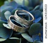 Wedding Rings On Violet Flower...