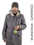 adult man holding ball isolated on white - stock photo