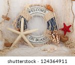 safe belt shell and starfish in a fishing net - stock photo