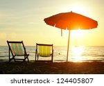 pair of beach loungers on the... | Shutterstock . vector #124405807