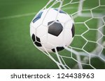 soccer ball in goal net with... | Shutterstock . vector #124438963