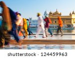 Group of Sikh pilgrims walking by the holy pool, Golden Temple, Amritsar, Pun jab state, India, Asia - stock photo