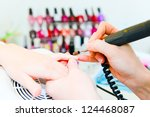 professional manicure in process   Shutterstock . vector #124468087