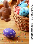 Easter eggs, cake, basket and chocolate bunny - stock photo