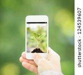 woman hand holding smart phone... | Shutterstock . vector #124539607